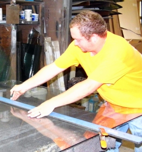 Cutting Glass in the shop.