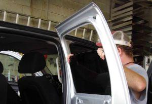 King Glass technician replacing door glass.