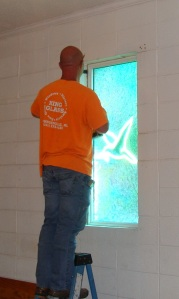 King Glass Technician installing Church Glass.